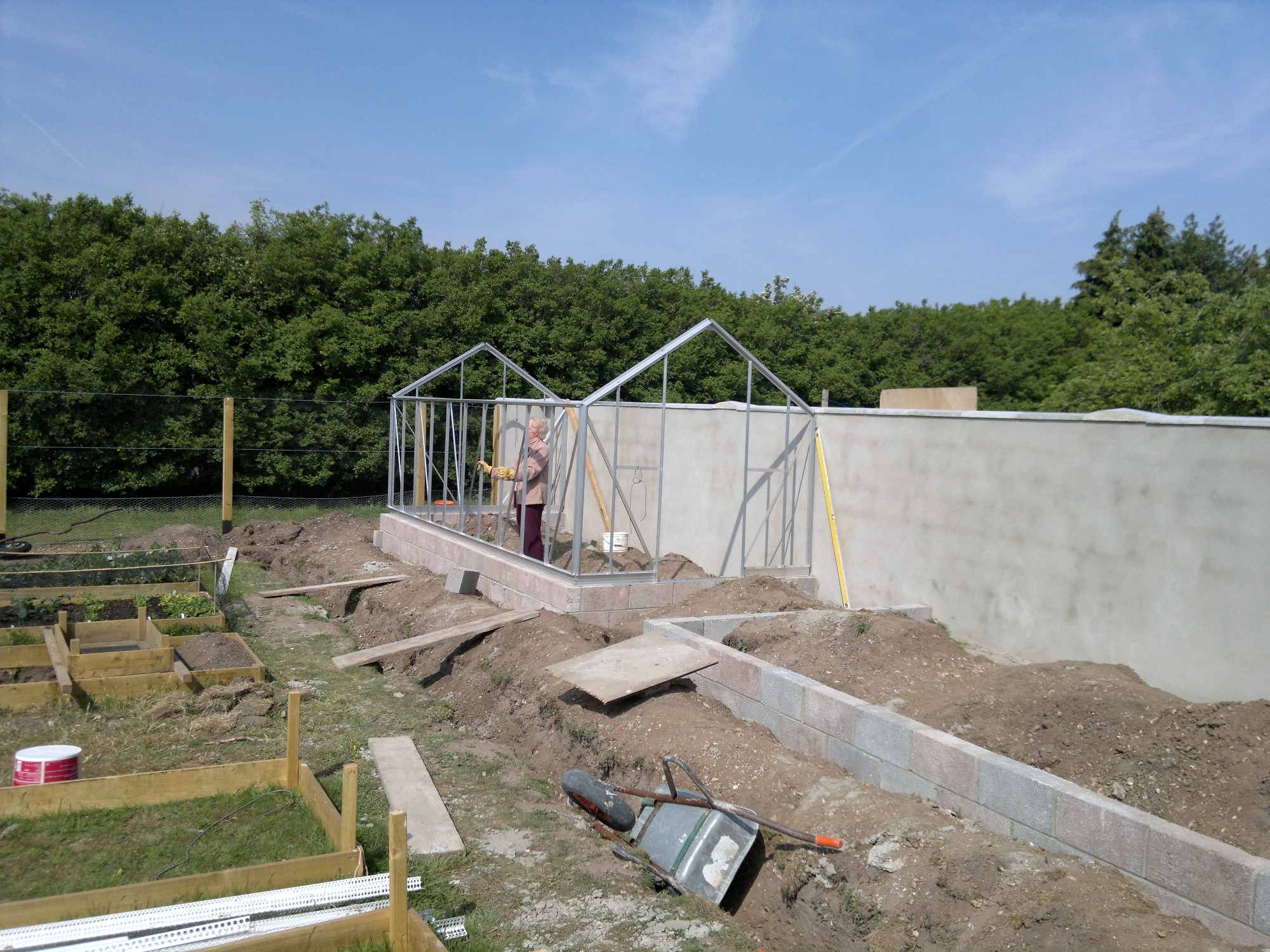 Mum patiently holding up the first glasshouse, while I am supposed to be looking for screws instead of taking pictures