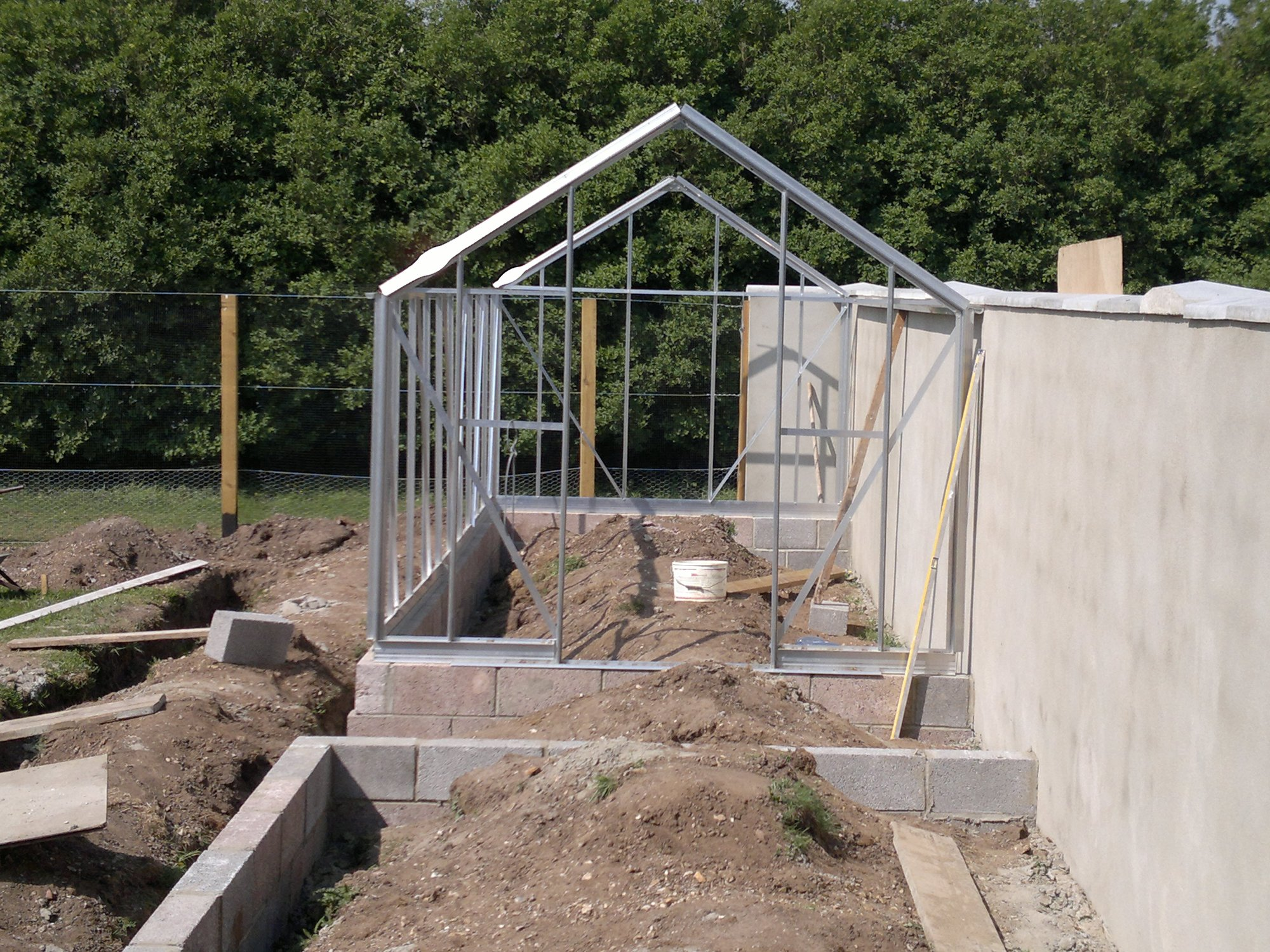 First of the main glasshouses secured to rear wall