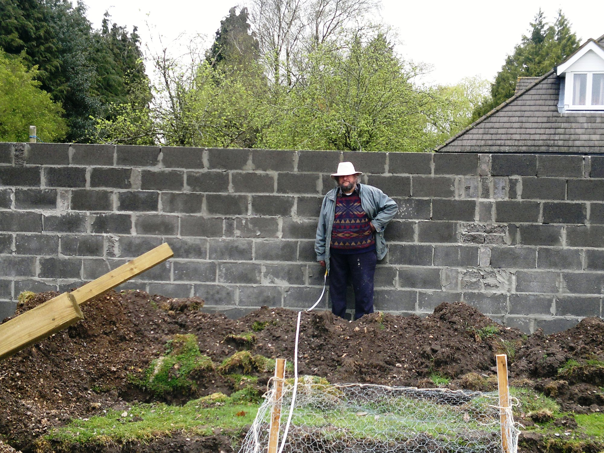 My dad, wondering why I am mucking about taking pictures when there is measuring to be done