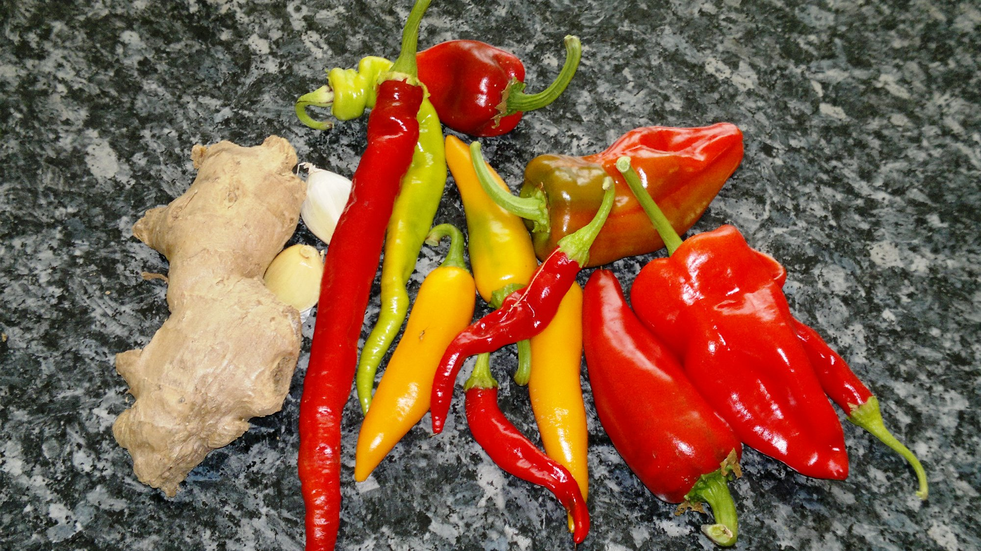 The aromatics: assorted chillies, ginger, and garlic