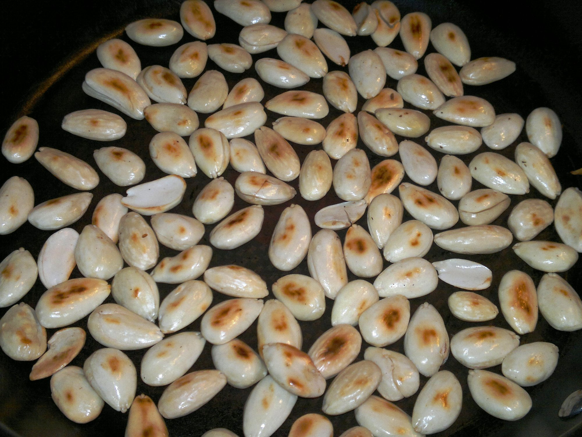 Blanched and toasted almonds replace the more usual pine nuts