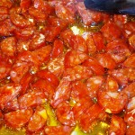 Chorizo picante cooking in olive oil until a little coloured