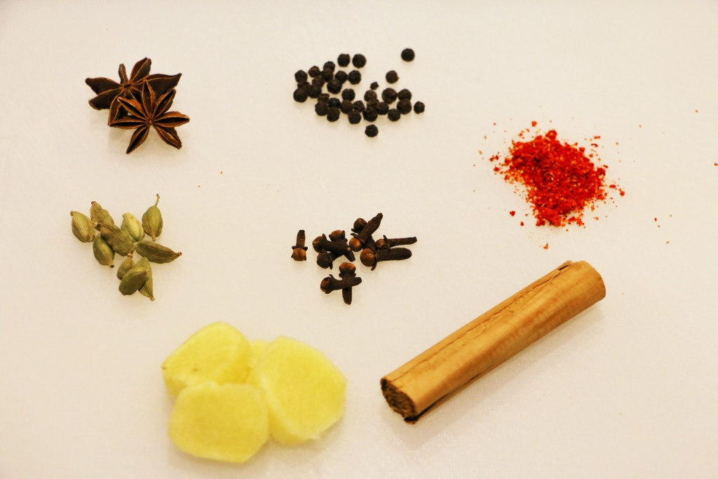 Some suitable spices: star anise, black peppercorns, chilli powder, cinnamon stick, fresh ginger, cardamom, and cloves