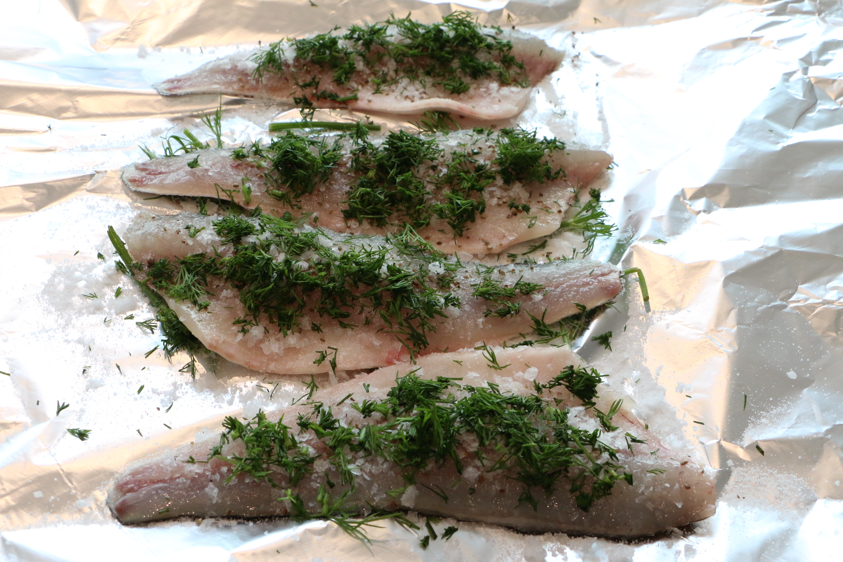 Gravad sea bass, ready to be wrapped and refrigerated for 24 hours